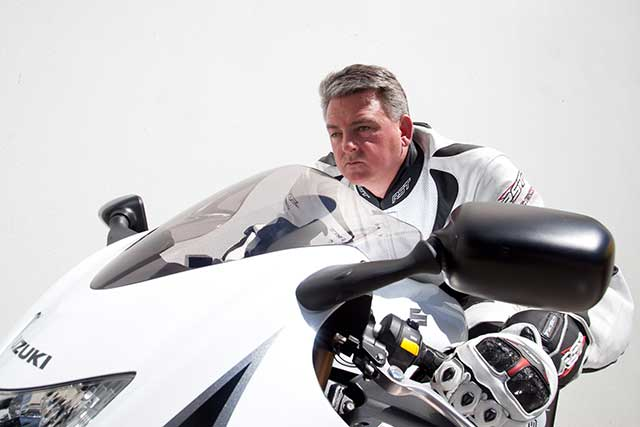 Ben Felten on white motorcycle