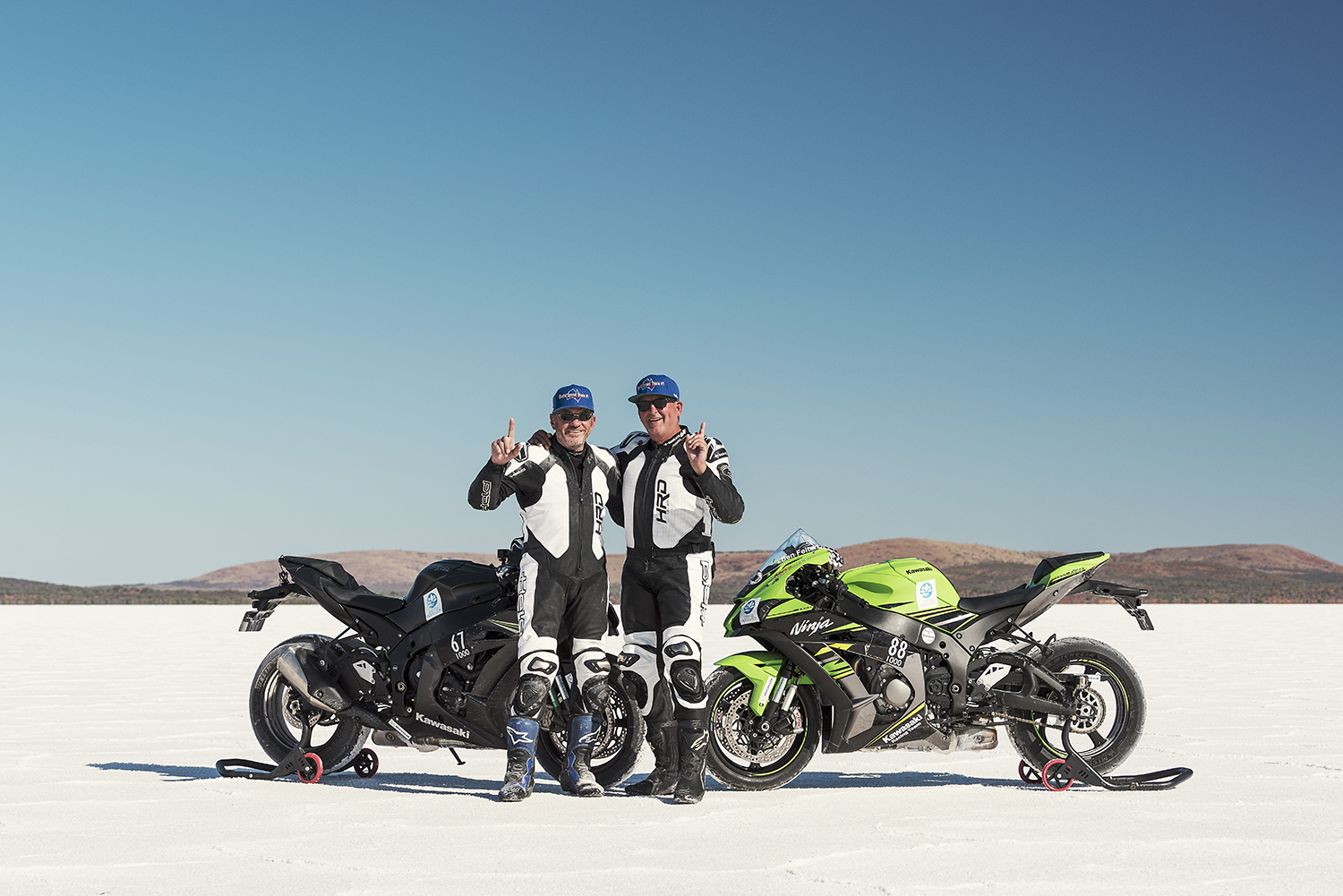 Kevin Magee and Ben Felten with black and green Kawasaki ZX10R motorcycles